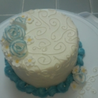Blue And White Cake A little 6 inch round cake I did just for fun to practice the swirls on the top. Two tone royal icing roses.