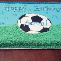 Soccer Ball Cake Half sheet carrot cake. Iced and decorated with cream cheese icing. FBCT ball.
