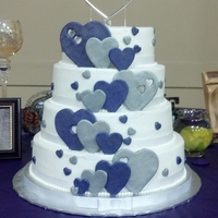 Purple And Silver Hearts Wedding Cake 4 tier cake-- 8, 10,12, 14 inch tiers with alternating chocolate and white cake and carrot cake for the top tier. Butter cream icing with...