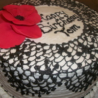 "This Is An 8 Zebra Cake With White Buttercream Icing And Black Buttercream Lace The Flower Is Gumpaste This is an 8"" zebra cake, with white buttercream icing and black buttercream ""lace."" The flower is gumpaste."