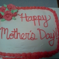 Gluten Free Mother's Day Cake Special order Mother's Day Cake covered in buttercream with a shell border, piped leaves, and fondant roses