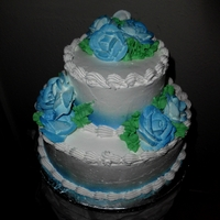 Elegant Blue Rose Bottom tier Tres leches, Top tier chocolate with cookies and cream filling and strawberry bettercreme filling. Whole cake is frosted in...