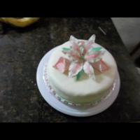 Fondant Cake With A Stargazer And Cala Lily Fondant cake with a stargazer and cala lily.