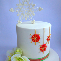 Contemporary Christmas Cake Contemporary Christmas Cake with quilled gumpaste snowflake and rice paper Helleborus.