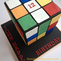 Rubik's Cube Chapeau! To all those of you, who re-created the Rubik's Cube in cake. Looking deceivingly simple, this design presents quite a...