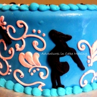 Flips Gymnastics round vanilla cake covered in fondant, gymnastic silhouettes made from black colored chocolate, pink icing accents