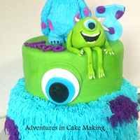 Monsters Inc Mike & sully are made from gumpaste/fondant, sully tier is all icing to look like his fur, top tier is red velvet covered in fondant...