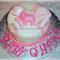"Pink Elephant 6"" round covered in fondant, pink bow and pink elephant"