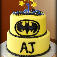 Batman Birthday Cake   Batman cake is covered in MMF. All decorations are also made from MMF.