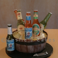 Beer Barrel Cake With Sugar Bottles  Everything is handmade and entirely edible..sugar beer bottles, custom edible labels, sugar ice cubes, etc. Design inspration--and advice...