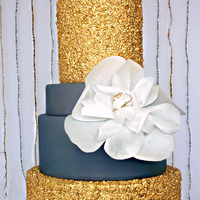 Sapphire Serenade This Five Tier Wedding Cake features two double barrel tiers of gilded sequins and an extra large wafer paper fantasy flower. And is Part...