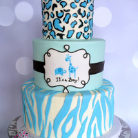 Animal Print Baby Shower Cake Sweet little three tiered Baby Shower cake – buttercream with fondant accents to match the parties plates.
