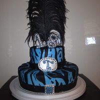 18 Birthday Cake --2 Tiered Blue Zebrastriped cake--buttercream icing--fondant decorations--feather on top--hand made 18 and T monogram--