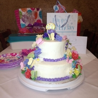 Flower-Butterlycake --2 Tiered Butterceam cake--Gumpaste FLowers and butterflies--butterflies attached with spaghetti noodlesTHANKS FOR LOOKING