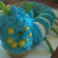 Cupcake Catapillar Butter Cake Cupcakes, Blue tinted Buttercream Icing, Licorice Strips and Lemon Drops.