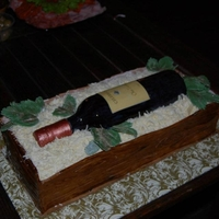 Wine Bottle In Crate Gum paste wine bottle, fondant crate, white chocolate shavings