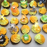 Wild Animal Cupccakes cupcakes I designed for a little boy who loves the outdoors and little critters! one of my first fondant figures