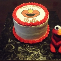"Elmo Cake With Fondant Elmo This is a 6"" round cake with an edible image of Elmo along with a gumpaste Elmo sitting next to the cake. 100% edible."