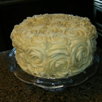 Red Velvet Cake W/cream Cheese Frosting Covered in roses!