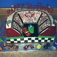 Cars Movie Race Track Cake Bottom tier was strawberry cake with chocolate buttercream filling and vanilla icing. Top tier was chocolate cake with chocolate...