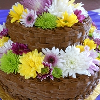 Flower Basket Two tier basket weaved cakes with natural flowers as decorations
