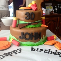 Skeet Shooter 30Th Birthday Clay pigeons,and shotgun shells made with marshmallow fondant