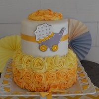 Yellow Ombre Rosette And Fondant Baby Carriage Cake Yellow Ombré rosette and fondant baby carriage cake
