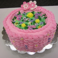 Pink Flower Basket Cake 2012   My first basket weave cake. This won second place in the beginner's class at the West Side Cake Club contest.