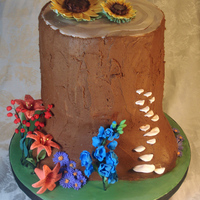 Tree Trunk Cake   Buttercream tree trunk with fondant flowers