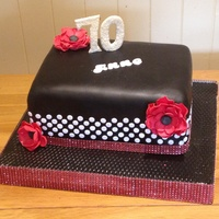 Anne's Black & White Polka Dot 70Th Birthday Cake Triple layer Lemon Drizzle cake with lemon curd and lemon butter cream filling. Polka Dots, Numbers, Name and Fantasy Flowers are made with...