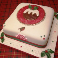 Plum Pudding Christmas Cake Rich fruit cake with marzipan underneath fondant. Robin Holly leaves and berries are made from gum paste. Plum pudding design on top of...
