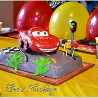 "Cars Lightning Mcqueen Cake Make a car cake by following these step-by-step instructions. Inspired by Lightning McQueen from the Disney Movie ""Cars"". Make..."