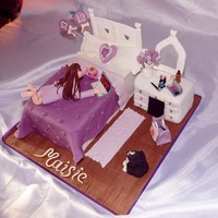 Teenager Bedroom Cake  This cake is for a little girl who turned 13, covered all the elements they wanted a chocolate dressing table and bed, her dog she grew up...