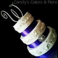 Purple Wedding All buttercream cake with fondant accents, a deep purple ribbon & broache.