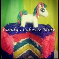 Rainbow Party!! *Buttercream Rossettes in purple and pink, with rainboe cake inside. Decoarted with a fondant pony.
