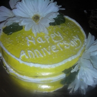 Yellow Anniversary Cake the flowers are not edible just wanted to give it a little natural touch,but the cake was lemon flavor with yellow icing a white crystals...
