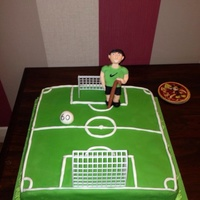Football Pitch Cake Made this for my uncles 60th birthday, he still plays football so that's him on the pitch with a walking stick lol