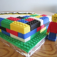 Birthday Cake For A 3 Year Old Boy Chocolate Cake With White Buttercream Lego Man And Blocks Are Made From Fondant His Name Was Done T Birthday cake for a 3-year old boy. Chocolate cake with white buttercream. Lego man and blocks are made from fondant. His name was done to...