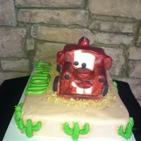 Mater Birthday Cake Vanilla Sheet Cake with Vanilla Buttercream covered with MMF. Mater is RKT covered with MMF.