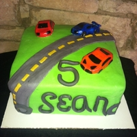 Cars 5Th Birthday Cake Chocolate Cake with Vanilla Buttercream covered and decorated with MMF. Cars are MMF
