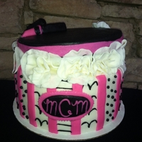 Antique Hat Box Cake Chocolate Cake with Vanilla Buttercream covered and decorated with MMF. Lid is RKT covered with MMF.