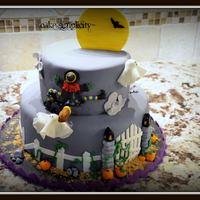 Frightful Landing Fondant covered cake with fondant decor for a halloween party