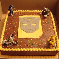 Transformer Cake Chocolate cake with chocolate icing birthday cake for a 5 year old. The mask is fondant.
