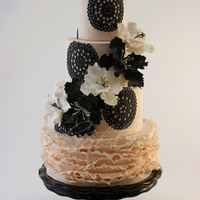 Black Doily & Peachy Ruffles  One of my favorite 2013 cakes, this beauty was inspired by the recent 'rustic chic' trends seen in wedding cakes, I came up with...