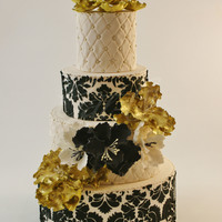 Black & Gold  This was a cake I created for a local wedding should back in October. Loved how velvety the damask stencil turned out... Seriously...