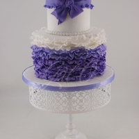 Ruffles And Bows...  So into ruffles lately! This one for a lovely young lady who had a birthday this past week-end! 5 and 7 inch cake with a purple ombre...