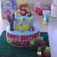 Angry Birds!! Whooohoo! Angry birds cake! All make from MMF except the 5 is gum paste. Fun cake to make really enjoyed making the birds and pigs:)
