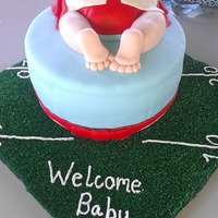 Football Baby!! Chocolate cake with chocolate mousse, this monks was craving chocolate!! Cover in MMF, all details made with MMF. My first baby bum cake...