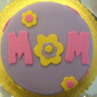 Made For Mom   white cake with strawberry white chocolate filling covered in marshmallow fondant