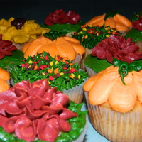Fall Cupcakes Grass With Fallen Leaves Pumpkins Fall Mums Fall cupcakes. Grass with fallen leaves, pumpkins, fall mums.